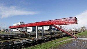 bridge across railway, modern slender bridge design by ipv Delft