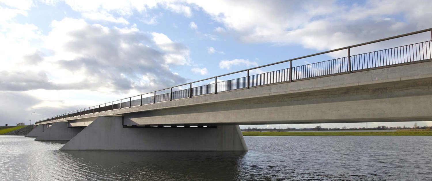 Noordwaard concrete traffic bridge integrated into landscape, simple but modern design